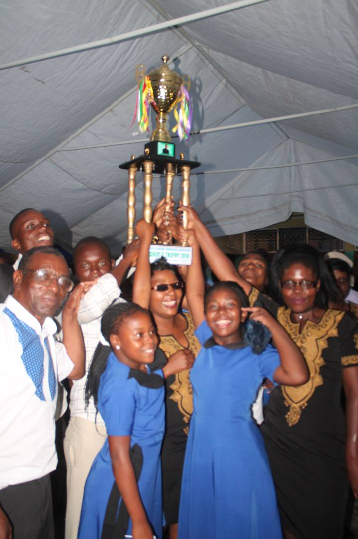Holy Trinity Cathedral Choir lifting the Bishop's Trophy in jubilation.jpg