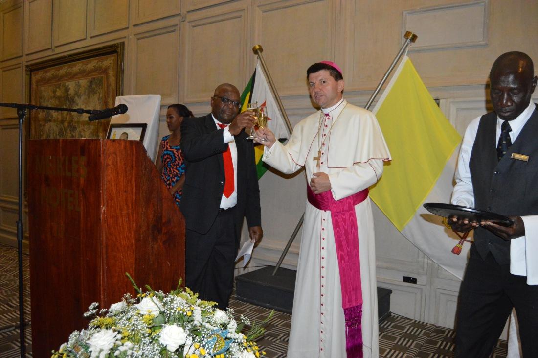 Ambassador Chitsaka Chipaziwa and Archbishop Marek Zalewski propose a toast..JPG