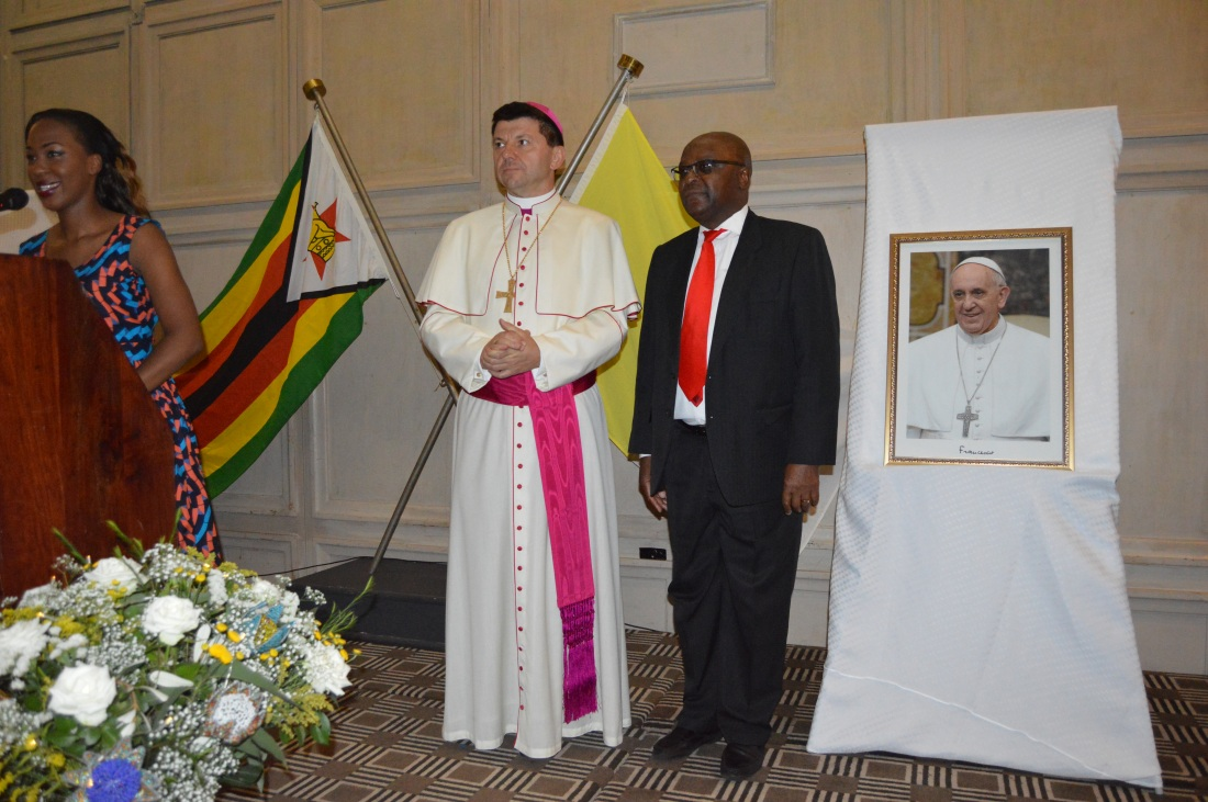 Archbishop Marek Zalewski with Ambassador Chitsaka Chipaziwa at a reception to mark the fifth anniversary of the Pontificate of His Hopliness Pope Francis.JPG