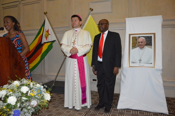 Archbishop Marek Zalewski with Ambassador Chitsaka Chipaziwa at a reception to mark the fifth anniversary of the Pontificate of His Hopliness Pope Francis.JPG