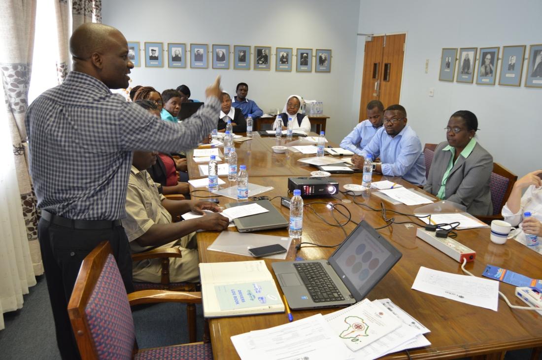 Caritas Coordinator, Chris Mwembe making a point..JPG