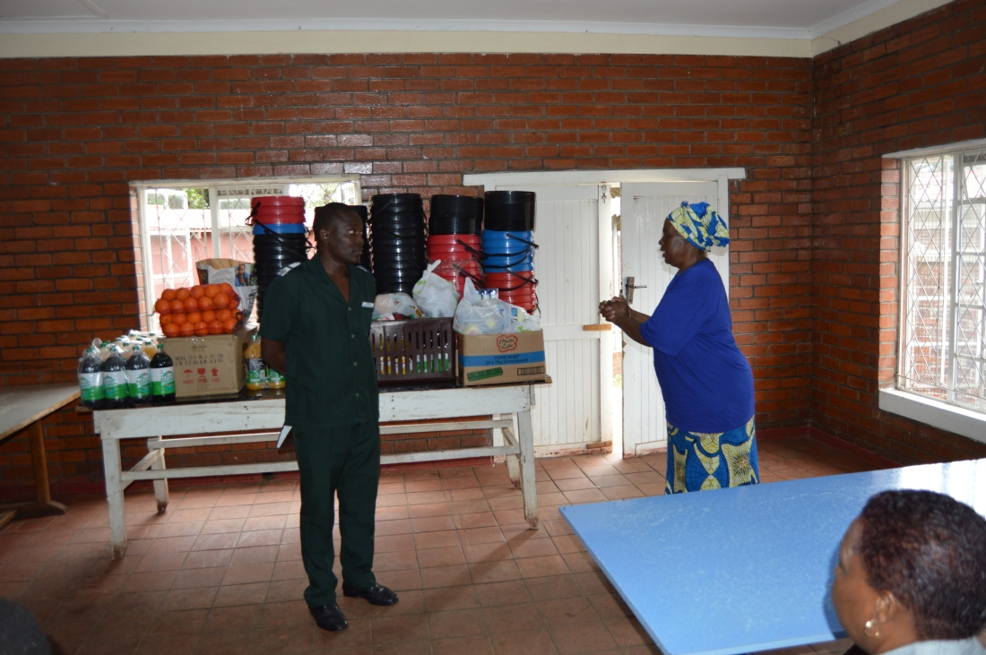 Mercy Servants Coordinator, Mrs. Dorothy Zakeo hands over the donation to Harare Hospital Nurse in Charge of Admissions, Sijabuliso Rutsvara..JPG