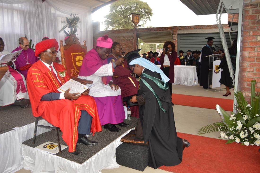 Catholic University Chancellor, Archbishop Robert Ndlovu caps Sr. Assumptor during the University's 2018 graduation..JPG