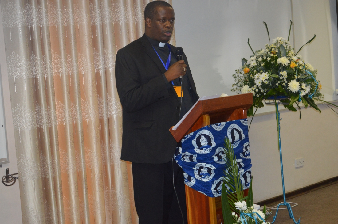 Fr. Jonannes Maseko, the National Youth Coordinator addressing the Plenary Meeting.JPG