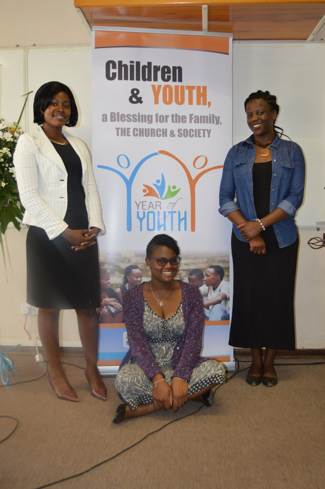 Three youth pause for a picture during the ZCBC 2018 Plenary Meeting.JPG
