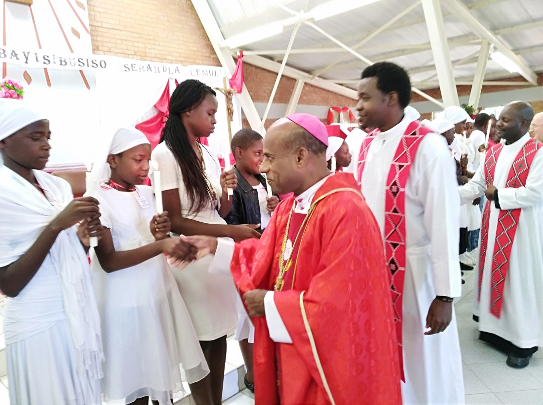 Archbishop Alex Thomas congratulates parishioners after confirmation..jpg
