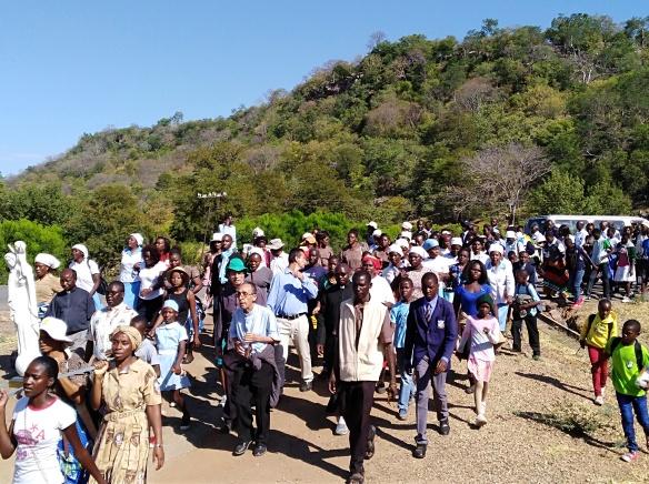 Bishop Albert Serrano is seen matching with pilgrims to St. Mary's Shrine in Lukosi..jpg