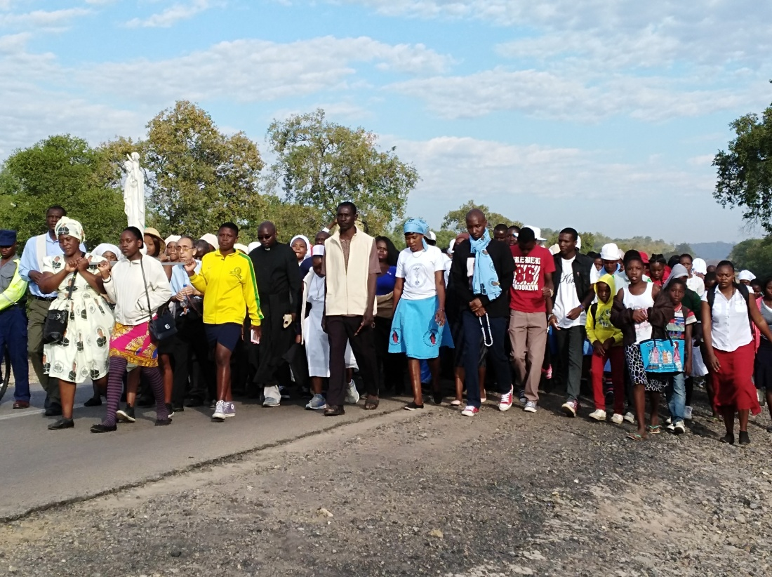 Pilgrims of Hwange Diocese match to St. Mary's Shrine during the Maria Unchena feast day..jpg