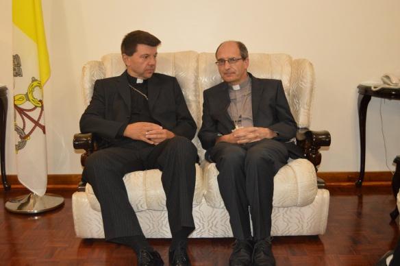 Archbishop Marek Zalewski chats with Bishop Paul Horan of Mutare.JPG