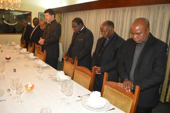 Archbishop Zalewski flanked by Bishop Michael Bhasera and other Bishops.JPG