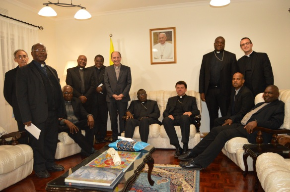 Bishops pose for a photo with Archbishop Mareki Zalewski at a parting dinner..JPG