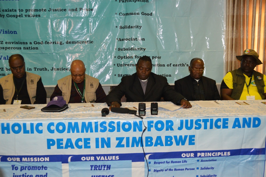 Bisho Rudolf Nyandoro flanked by IMBISA Director, Fr. ClaudiBishop Germano Grachane from the Diocese of Nacala and ZCBC Secretary General, Fr. Fradereck Chiromba and the National Coordinator for CCJP, Mr. paul Muchena..JPG
