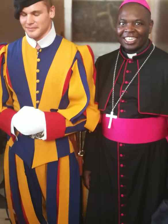 Bishop Rudolf Nyandoro with the Swiss Guard in Rome.