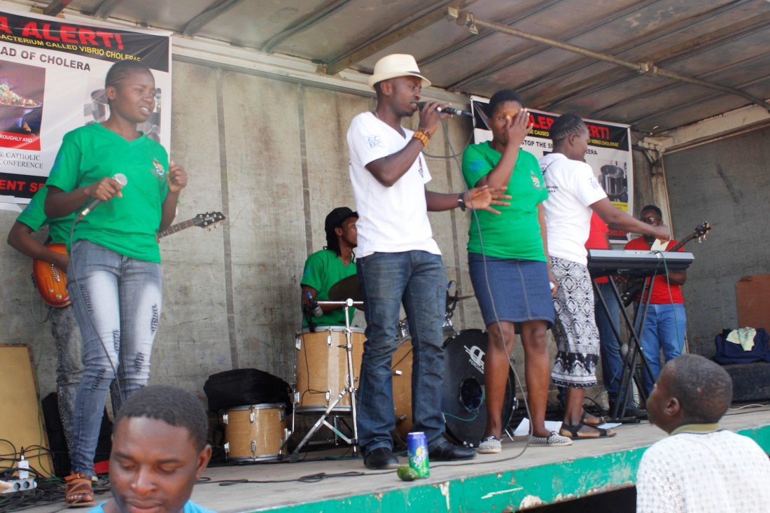 Brian Nyahuma entertains the community in Chitungwiza during the ZCBC cholera awareness raising campaign..jpg