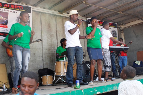 Brian Nyahuma entertains the community in Chitungwiza during the ZCBC cholera awareness raising campaign..jpg