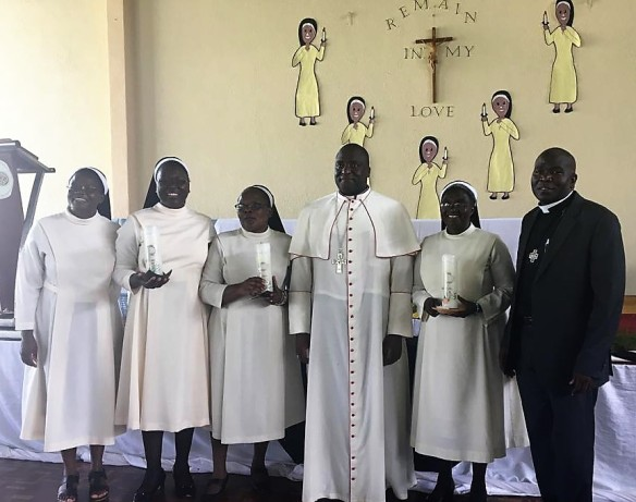 Bishop Raymond Mupandasekwa (middle) and Fr. Chota pose for a picture with three of the jubilarians.