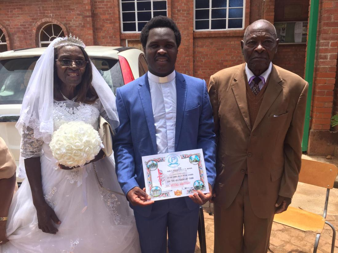 Fr. Claud Maganga (middle) pose for a picture with Mr. and Mrs Savanhu.