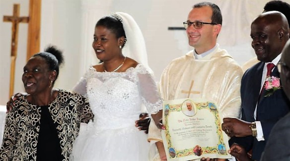 Mosingnor Gabriele Pesche (middle) pose for a picture with Mr. and Mrs. Mekani who received the Papal blessing at their 25th wedding anniversary.