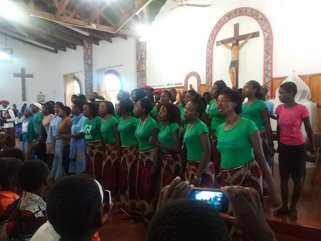 Members of St. Fidelis choir doing what they know best at St. John's Makwa where they had come for an exchange musical programme.