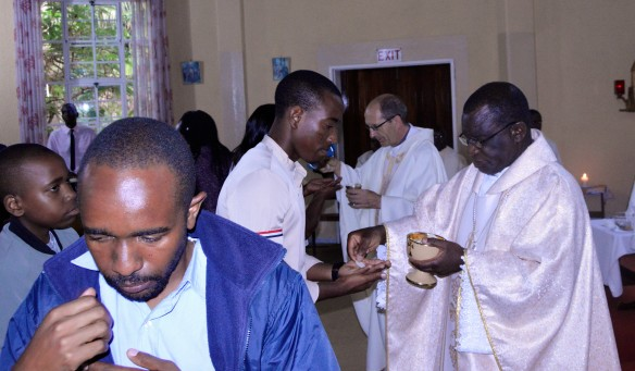 archbishop robert ndlovu of the archdiocese of harare (right) and bishop paul horan of mutare distribute holy communion to pilgrims to panama during a farewell mass at rockwood spiri