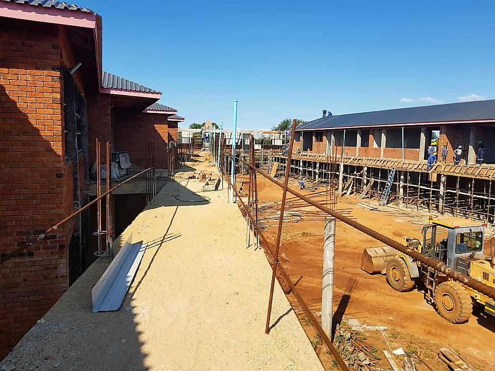 Men at work; contractors put final touches to the huge Sacred Heart College scheduled to open in January 2020.