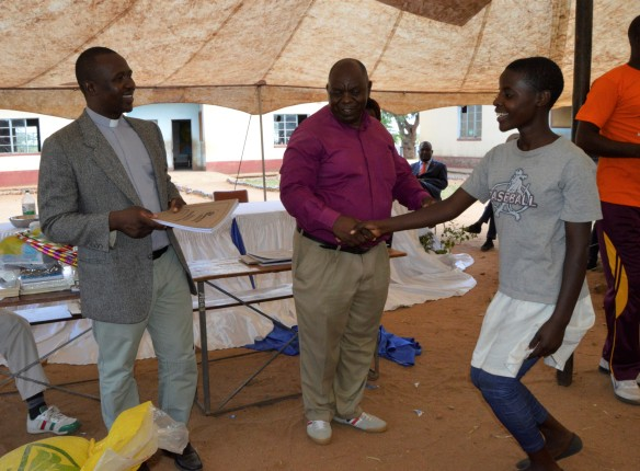 Fr. Moyo and Fr. Ziumbwa hands over prizes 1