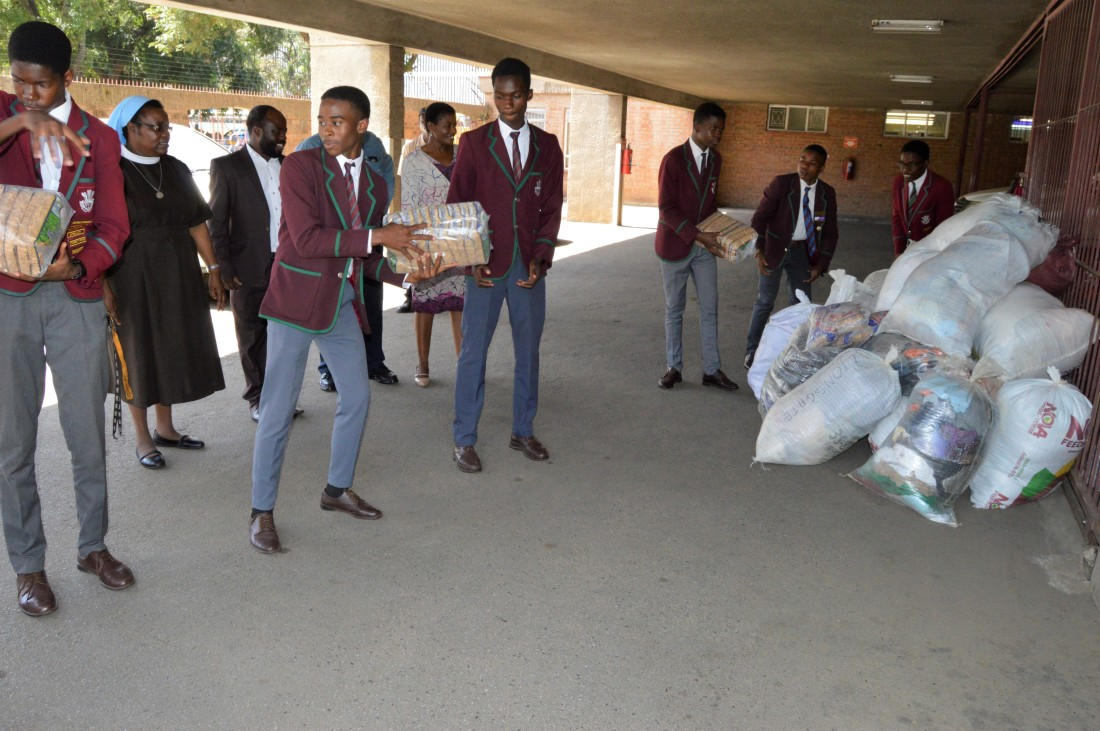 Prince Edward High School Club offloads donated items destined for St. Charles Luanga that was hit by Cyclone Idai.