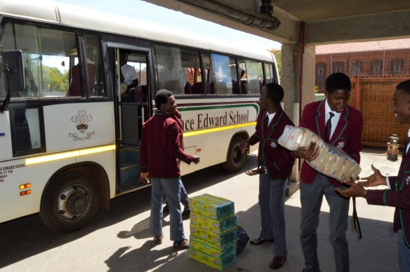 The Interact Club members offload items from the Prince Edward school bus.