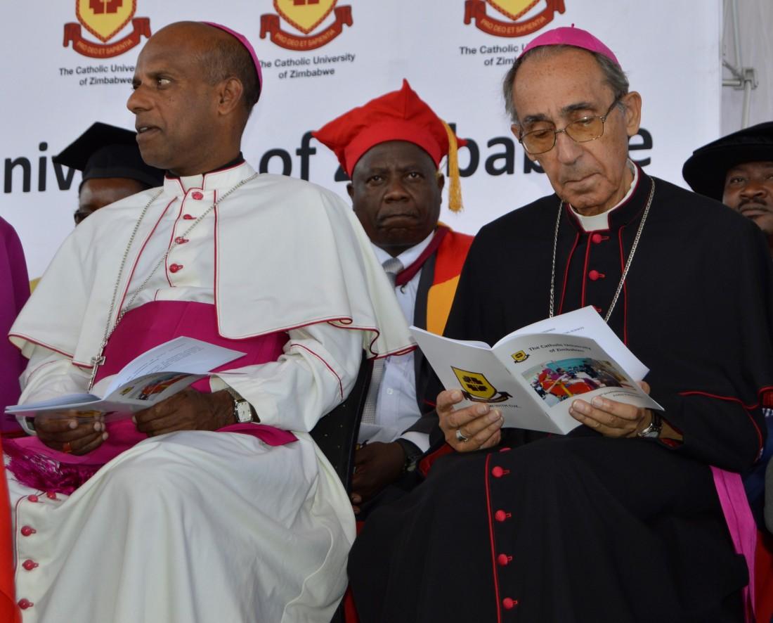 Archbishop Alex Thomas and Bishop Albert Serrano follow proceedings at the CUZ 16th graduation.