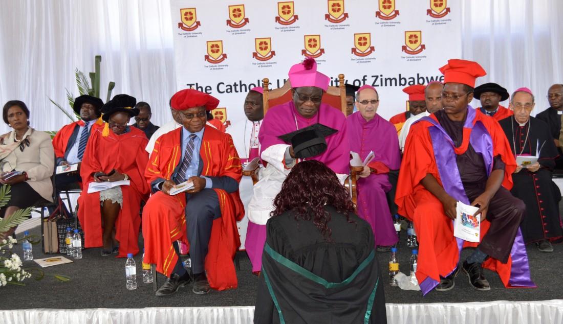 Archbishop Ndlovu caps one of the graduating students.