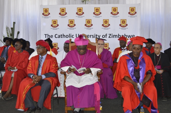 Archbishop Ndlovu flanked by the Vice Chancellor of the Catholic University, Professor Ranga Zinemba and the University's Registrar, Br. Albert Mada.
