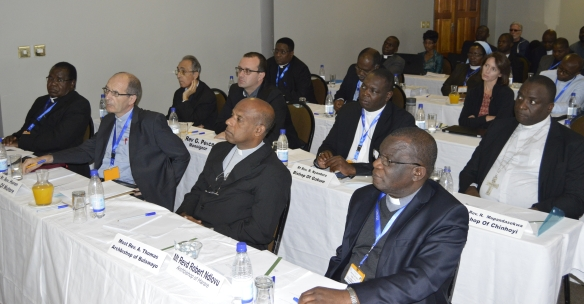Bishops and delegates pay attention during deliberations at the plenary.