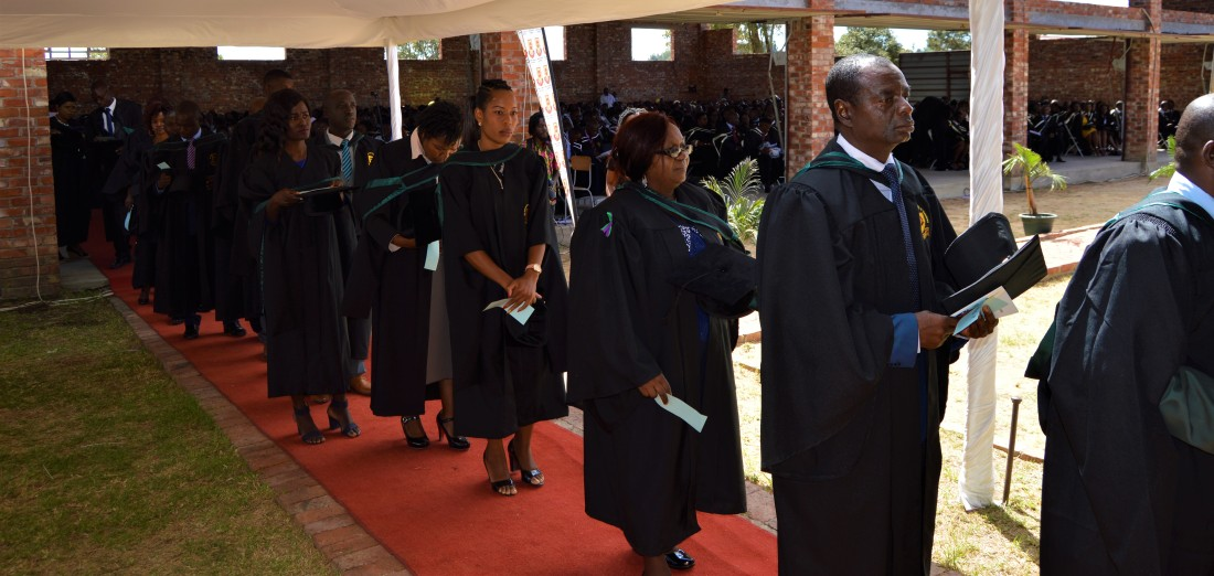 Graduating students line up to be capped by the Chancellor of the Catholic University, Archbishop Robert Ndlovu.