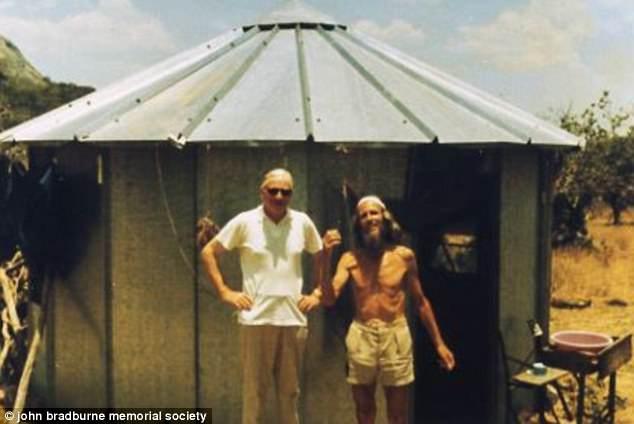 John Bradburne with Fr. Dave Outside John Bradburne's hut known as 'Pipers Vale' in Zimbabwe.