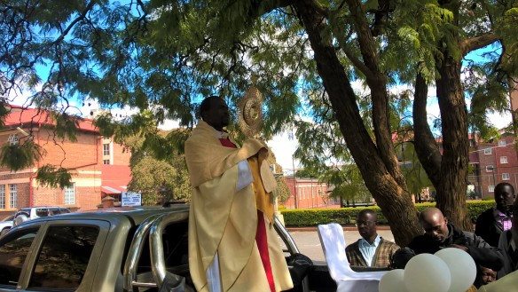 Fr. Muguti holding ready to lead the procession during Corpus Christ.
