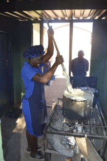 A cook prepares food the students at the Low Cost boarding at Nemangwe High School in Gokwe.