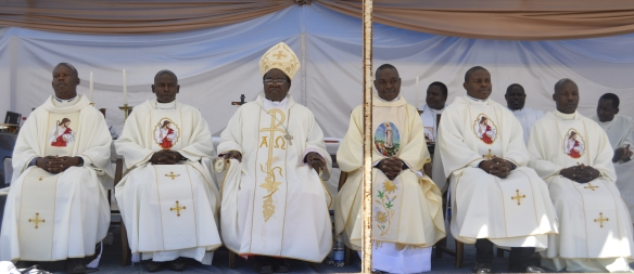 Bishop Bhasera is seen flanked by the new priests after teh Ordination at Mkoba Stadium in Gweru.
