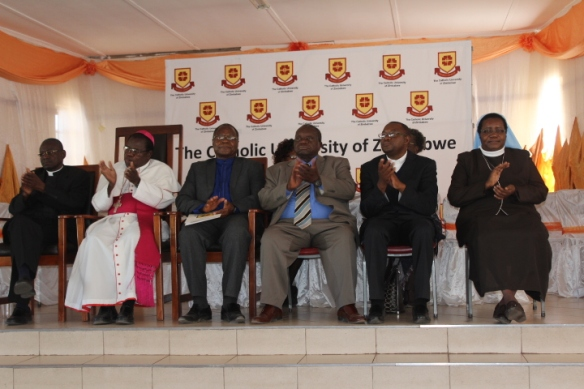 Bishop Michael Bhasera in white Cassock flanked by Fr. Walther Nyatsanza, Professor Ranga Zinyemba, National Education Secretary Sr Theresa Nyadombo and others at the launch of the Catholic University Campus in Masvingo rec