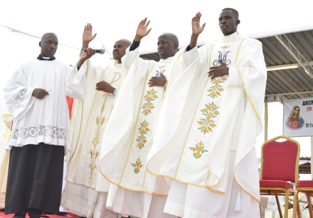 frs.-price-mandizvidza-madzivanyika-cmm-brian-francis-kandlela-and-vusimuzi-golden-moyo-blesses-the-congregation-soon-after-their-ordination..jpg