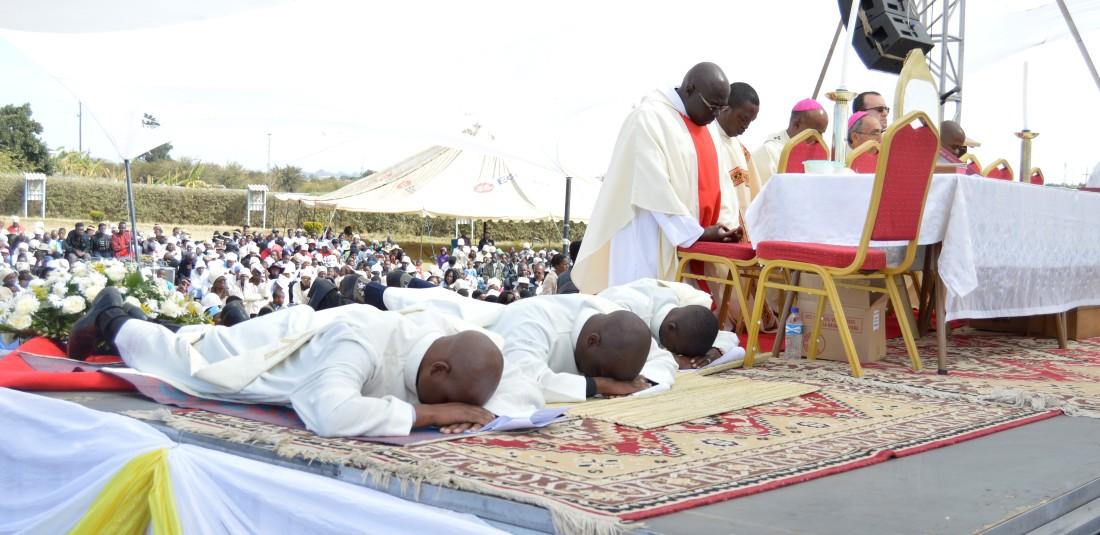 Rev. Prize Madzivanyika, Rev. Brian Kandlela and rev. Vusimuzi Moyo Moyo lie prostrate in humility before their ordination by Archbishop Alex Thomas in Bulawayo.